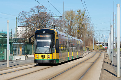 DVB Tram on Route 7 approaches Dresden HBf on Wiener Platz past InerCity Hotel