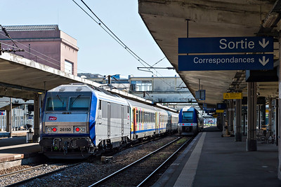 Sibic 26150 propels a semi-fast from Mulhouse platform 3 past Bombardier 27859 at platform 4