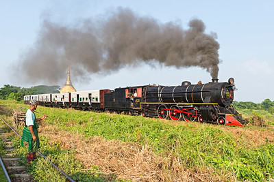 Class YC  4-6-2 No 629 with passenger train heads south from Pa Ya Gyi passing a local farmer