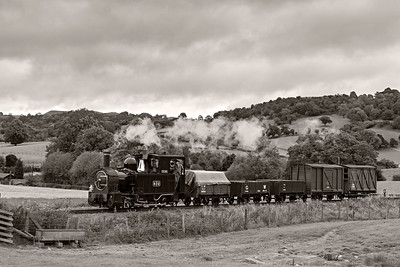 The Earl #822 in the country near Cyfronydd Sta with a Llanfair bound freight 3 BW