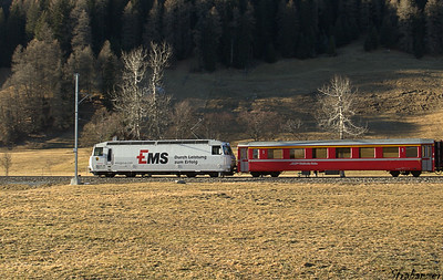 "This work is licensed under a Creative Commons Attribution- NonCommercial 4.0 International License.  Islen, Graubunden, Switzerland    12/27/2016 Ge 4/4 III Loco #643 ""Vals"" bearing logo of EMS Chemie Holding AG"