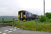 Class 150 Sprinter 150232 has just crossed the Wellpark Road Level Crossing near Albaston on the Tamar Valley Line operating the 13:45 Gunnislake to Plymouth service on May 29, 2014
