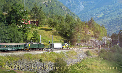 Flåmsbana photographed on Monday August 06, 2012. A down train see from an ascending train at Berekvam Station the only passing loop on the Flåmsbana. The station is slightly over halfway between Flåm and Myrdal.