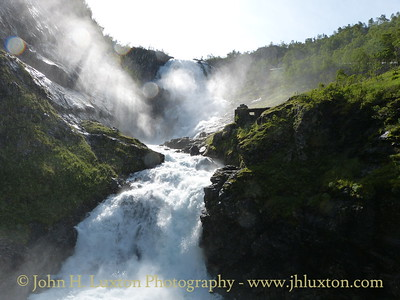 Flåmsbana photographed on Monday August 06, 2012. Kjossfossen Waterfall viewed from the Kjosfossen Station platform.  The air is full of moisture from this spectacular waterfall.  Trains make a photo stop here.