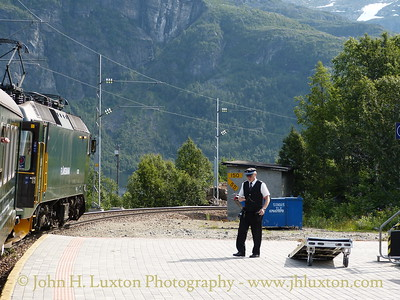 Flåmsbana photographed on Monday August 06, 2012. The conductor on the platform at Vatnahalsen Station the first station downhill from Myrdal.