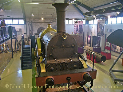 IRON DUKE is a replica of one of 29 locomotives of her class none of which survived. The replica locomotive was built by RESCO in 1984 using modern materials and methods with some donated parts from a scrapped tank engine, to celebrate the 150th anniversary of the G.W.R.    It was photographed here on display at the Maritime Heritage Centre at Bristol in 2006 which is adjacent to the SS Great Britain as part of the Brunel 2000 Celebrations.  The locomotive is usually based at the Great Western Society base at Didcot, which has broad gauge track, but in 2019 had been out of use for some years due to an expired boiler certificate.