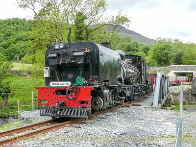 Number 143 an ex – South African Railways NGG 16 Class Garratt built by Beyer-Garrett of Manchester in 1958. She is seen crossing the Glaslyn River over the rebuilt Bryn y Felin bridge at the easterd end of the Aberglaslyn Pass on May 26, 2009.
