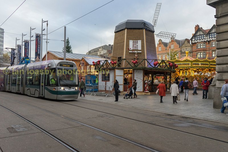 207 in the middle of the festive lights and market preporations as it pulls away from the Old market square stop