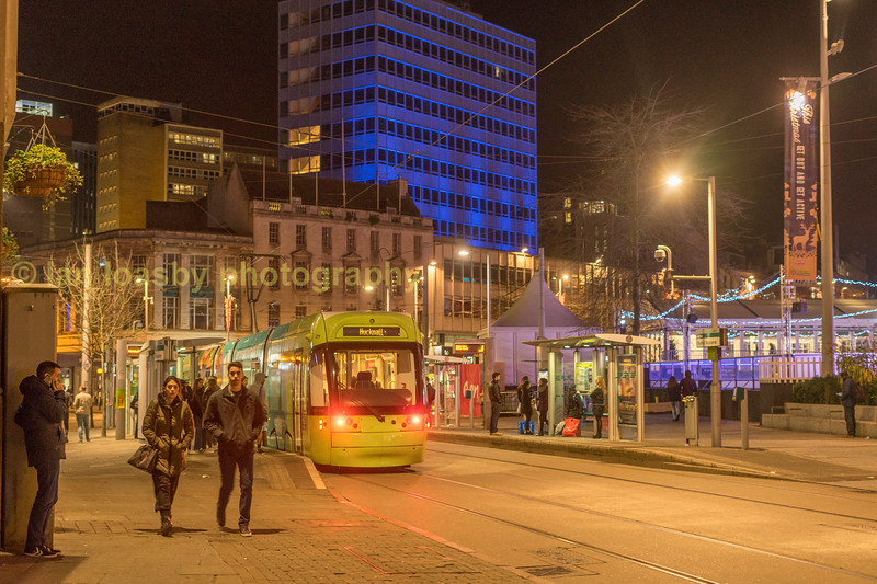Bombardier 211 at the old market sq stop, to the right on the square nottinghams christmas market is in full swing