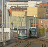 A near enough side by side shot of left A Bombardier INCENTROS & right a Alstom CITIDAS NET trams as the depart / arrive at the Nottingham station tram stop