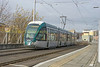 Citidas 218 departs Nottingham Station tram stop norhbound for the city centre