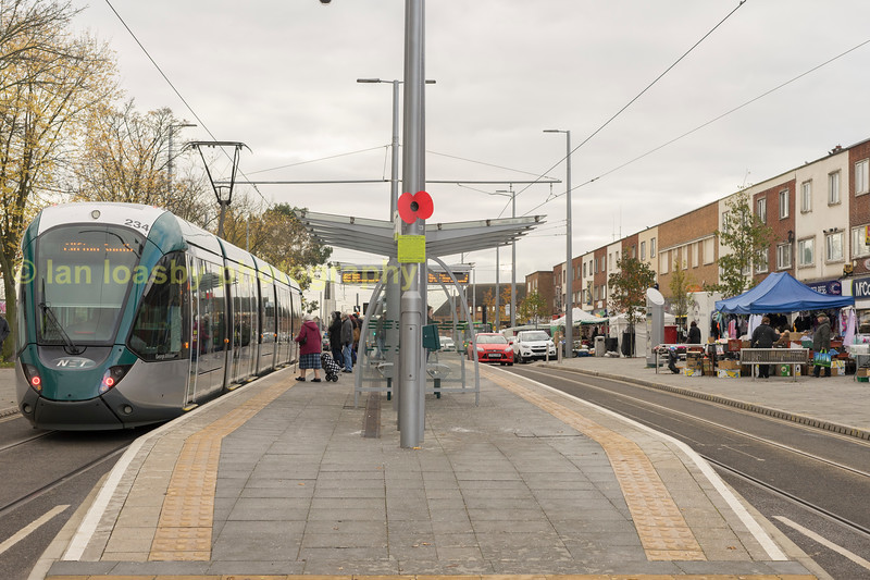 234 at the Clifton centre stop with a tram for Clifton south.