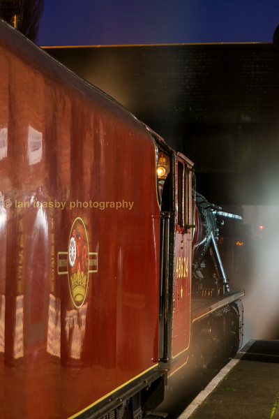 The red 8 which is now a black 8, the resident Stanier 8F with a night time departure at Loughbough on the GCR