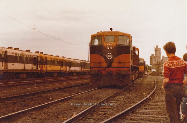 077 (CIE Branding & livery) Inchicore (Note sound barrier of old B Class 101 diesels) D Heath