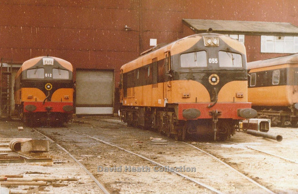 012 & 055 (CIE Branding & Livery) Inchicore Wks c 1983  D Heath