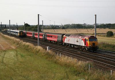 57 312  1725 Manchester Llandudno, passing a Silverlink class 350 26/7/06