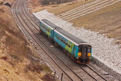 156473 climbs against the 1 in 163 pull with a class 2 all stations stopping service, 2H88 1244 Leeds to Carlisle.