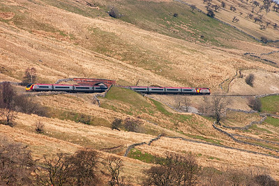 The line clings to the side of Wild Boar Fell as it descends to Ormside Viaduct, two miles south of Appleby.