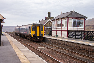A Northern Rail class 1 train passes Garsdale 'box, 156441 forms 1M53 0949 Leeds to Carlisle. This train used to go on to Glasgow Central but was cut back a few years ago.