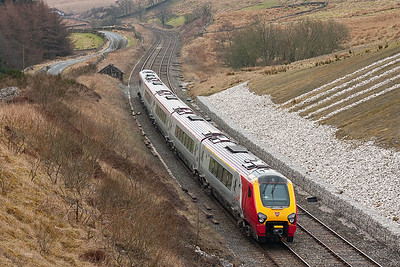 The view from the south side of the short tunnel and an unknown class 221 Voyager clears the tunnel with 1V70 1128 Carlisle to Plymouth VXC train.