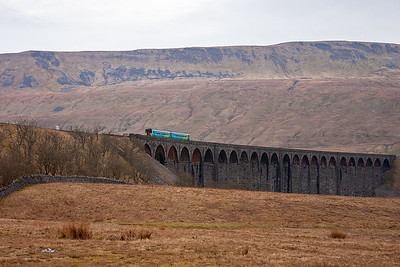 After a night in the Station Hotel being woken every few hours by passing coal trains then a hearty breakfast, it is time to head out to enjoy a day of diverted Virgin West Coast trains. But first something local, 156489 with 2H03 0752 Carlisle to Leeds coming off the Ribblehead Viaduct.  15/4/2006
