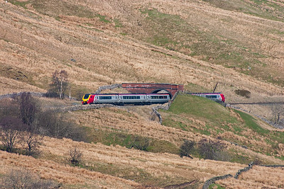 The sunlight in Mallerstang is beautiful as the sun warms the hillside with 221133 climbing for Ais Gill summit with service 1V61 1128 Carlisle to Penzance.