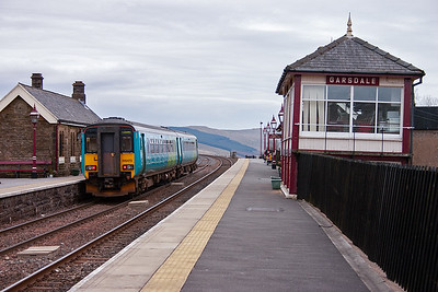 The unit squeals to a stand at the former island platform. Trains from Hawes and Northallerton ran in on the opposite side. The station was originally called Hawes Junction.