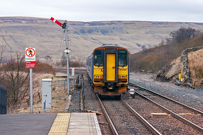The pairing departs the former junction station passing the down starter.  The famous stockaded turntable was sited to the left of shot.  The pit is still there.