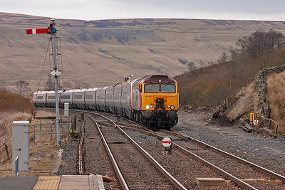 Virgin thunderbird loco 57303 approaches Garsdale station hauling Pendolino unit 390047 with 1A58 0902 Carlisle to Euston service diverted via the Settle and Carlisle line and Blackburn.