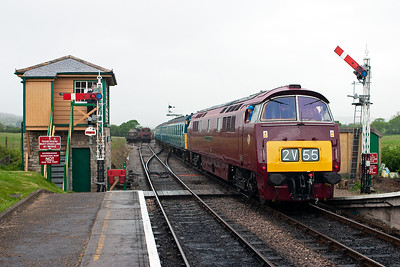 On the back of the EMU is D1015. The shuttle departs from the down platform that is signalled for bi-directional running.