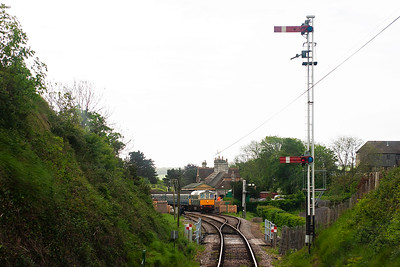 D1015 comes to a stand at the double acting down home signal at Corfe Castle.  The up train is in and waiting for us.
