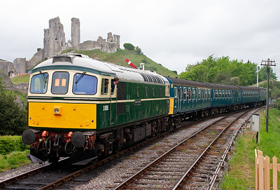 The ruins of Corfe Castle form the backdrop to D6515 on the rear of 3417 leaving Corfe station.