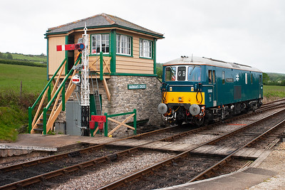 E6043 or 73136 is privately owned but is operated on the main line by GBRf. Here it emerges from the sidings at Harmans Cross passing the 1996 built signalbox.
