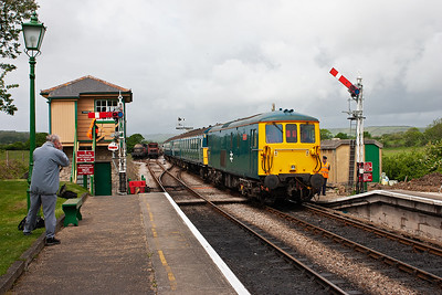 Train 2N06 departs Harmans Cross at 1105 for Norden with 73208 passing the 'box.