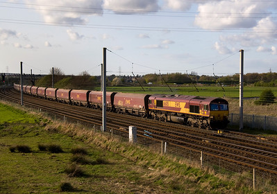 66015 is on the Fiddlers ferry coal circuit, passing Winwick with 6F84 from liverpool 12/4/11