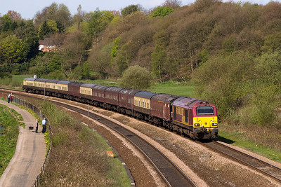 By the time the last of the three trains came, the sun had come round to a better angle.  67022 heads a rake with distinctly patchwork appearance on 1Z35, Horwich to Wembley .   Considering Bolton got soundly trounced, it could be a long time before we see anymore of these trains.  17/4/11