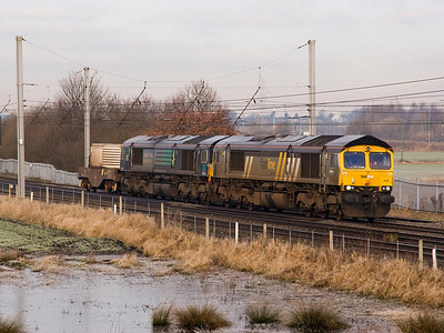 At Winwick Junction superpower for a single flask!.   66434 still in Fastline livery leads 66424 on 6K73 Sellafield - Crewe.   29/01/11