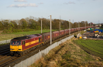 On the same day, 60049 is passing Winwick heading from Fiddlers ferry to Liverpool.with 6F 09.  The stuff in the field on the right is all associated with track renewals, at Winwick.   12/4/11