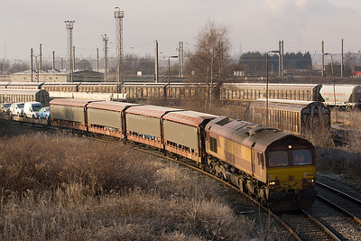66068 being dragged past Arperly yard on a train of car transporters 29/01/11