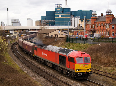 60011 brings 6F78 Fiddlers Ferry - Liverpool empty coal hoppers under warrington Bank Quay station