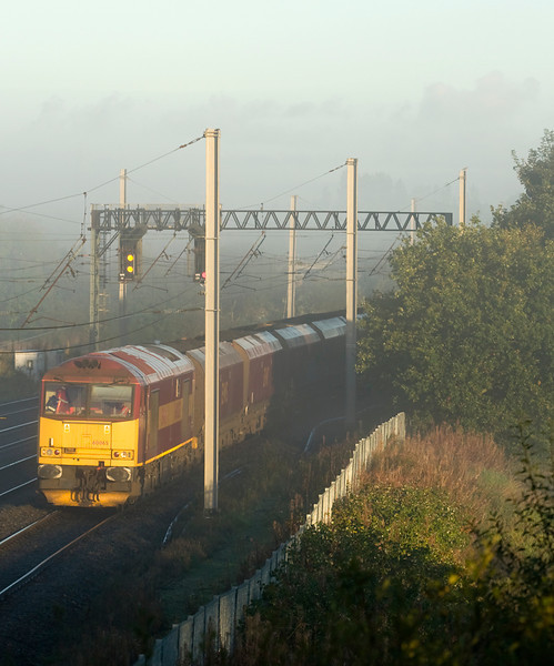 60065 emerges from the mist at Winwick with 6F89 Liverpool- Fiddlers Ferry.  6/10/12