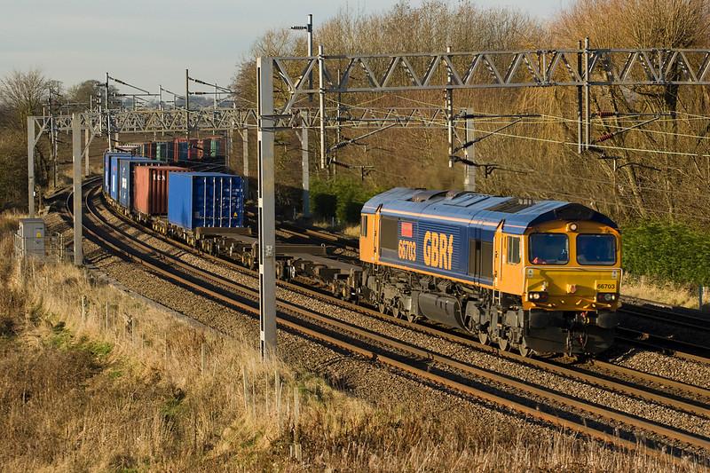 66703 heads past Heamies Farm with 4L18 Barton Dock-Felixtowe intermodal service on 29/11/12