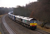 As 2012 heads towards a rain-soaked end 4S43 Daventry Mossend  was diverted away from the WCML fdue to  engineering works, Here it is leaving Bolton at Ladybridge on 29/12/12 behind 66424 and 66305