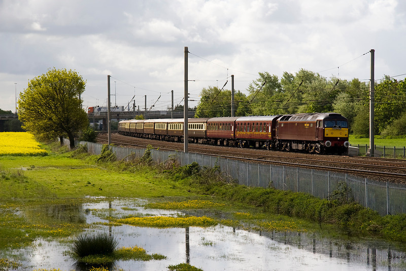 57001 leading 1Z73 Milton Keynes - Carlisle excursion crawling up the slow line at Winwick - Just manging to keep in the sun - frustratingly just when a lorry heads over the bridge!!! 12/05/12