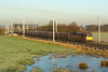 60045 heads 6F81 Liverpool Fiddlers ferry past Winwick - 14/01/12