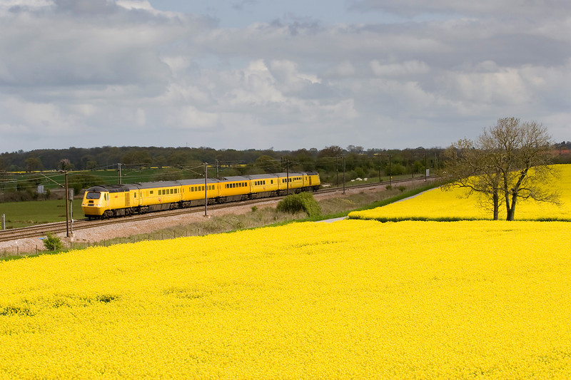 Yellow Peril - Network Rail's New Measurment Train (43013 abd 43062)  heads past a field of oil seed rape at Colton Jct:  1Q34 Derby to Heaton on 05/05/12