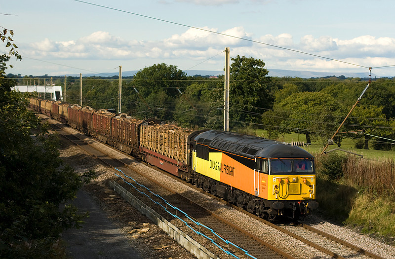Colas class 56 - 56094 takes charge of the saturday 6J37 Carlisle -Chirk Log train just south of Balshaw Lane   This was the first time that a 56 ahd been in charge of the southbound run and the photographers were out in force.  22/09/12