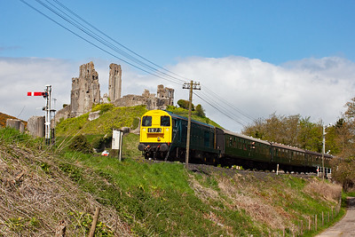 "Corfe Castle now and 20147 runs in with the castle ruins towering above the train, 2S07 1130 Norden to Swanage. Nice as this loco is, I really wanted Peak D4 ""Penyghent"" which was booked but failed a few weeks previously."