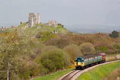 The train drops down over Corfe Common and we can see 31446 is in EWS livery.