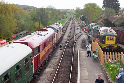 The down train is 2S09 1215 Norden to Swanage and they pause at Corfe with D9009 to the right.